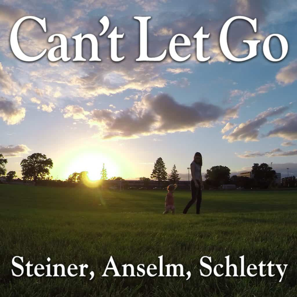 Album art for Can't Let Go by Steiner, Anselm and Schletty. A glorious sunset with warmly lit clouds. A young mother and her toddler walking on soft green grass.